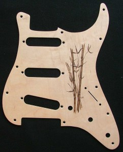 Bamboo design woodburned on maple veneered aluminum pick guard - raw wood