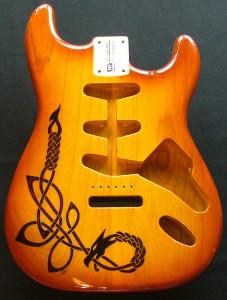 Celtic dragon design woodburned on guitar body