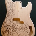 SOLD - Human heart design woodburned on P bass guitar body - raw wood