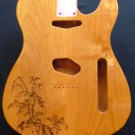 Traditional Japanese landscape design woodburned on guitar body