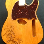 Traditional Japanese landscape design woodburned on guitar body with optional pick guard