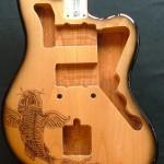 Koi fish design woodburned on guitar body with black burst finish