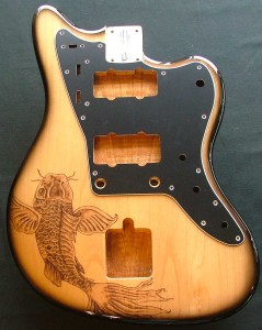 Koi fish design woodburned on guitar body with optional pick guard