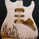 SOLD - Phoenix design woodburned on guitar body - raw wood