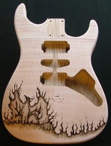 SOLD - Phoenix design woodburned on guitar body - raw wood