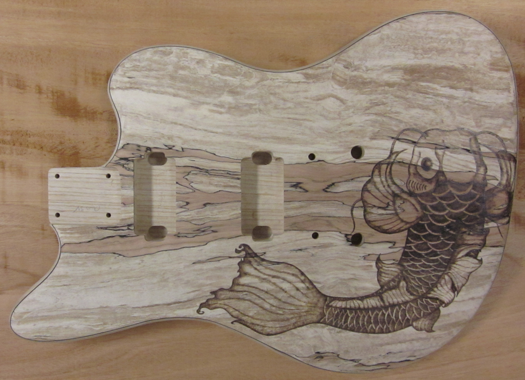 Commissioned woodburned guitars dark artz woodburning for Koi fish guitar